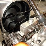 Custom power steering reservoir designed to fit serpentine pulley system