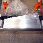 Custom coolant overflow resirvoir designed to fit below the radiator