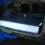 Custom fuel tank designed to be maximize the area of the trunk floor